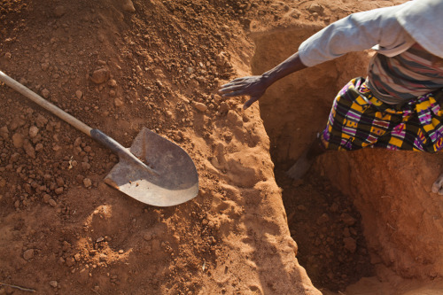 "Somali refugees dig the grave of Ibrahim Issack, a six-year-old child who died of complications of severe malnutrition a month after arriving in the camp, according to his uncle Hassan Issack. ""We fled Buaale and traveled for 21 days by foot. It was very tiresome. we walked through drought with no food and little water. Along the way we were robbed and women were raped."" (Brendan Bannon/Polaris Images)"