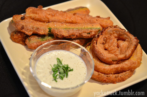 Beer Battered Zucchini & Onion Rings with Raw Vegan Ranch! Warning: this recipe is INDEED as good as it sounds, and is also probably one of the unhealthiest things on my blog. I haven't had fried zucchini or onion rings in ages and need to use the rest of the squash that I pulled from my garden, and also had a recipe sent to me that was Beer Battered Avocado fries; so I combined the two to create this magical meal.Ingredients: One 12 oz. Alaskan White (belgian) or any light beer 1 Cup Whole Wheat flour (may need to add a couple more tablespoons) 1 Tbsp. Nutritional Yeast 2 tsp. Paprika 11/2 tsp. Sea Salt 1 tsp. Garlic Powder 1 tsp. Onion Powder A pinch of Cayenne Pepper 3/4lb. Zucchini/Summer Squash, cut into long sticks 1 Whole White Onion, Sliced into rings Vegetable Oil, as needed for fryingDirections: Mix all dry ingredients in a low, wide dish; then pour in beer and whisk together until there are no clumps. If the batter seems too runny, add a little more flour; you want it to be able to coat the zucchini without completely clumping on it. Set batter aside in the refrigerator for 1-2 hours.Fill pan or fryer with the oil and heat to roughly 375F, if you are using a pan (like I did) this is somewhere between medium and high heat. Dip each zucchini stick in the batter and make sure it is entirely coated, use a fork or two to lift it out of the batter and CAREFULLY place it into the hot oil. Fry until golden brown, 2-3 minutes; then take out of the oil, drain off as much oil as possible, place on a paper towel covered plate and sprinkle sea salt and nutritional yeast over them. The same instructions apply to the onion rings. For the Raw Vegan Ranch! I found this SUPER EASY ranch recipe on The Sunny Raw Kitchen, except that I made only a third of it (it's a huge recipe). It tastes amazing, no lie, and doesn't involve processed ingredients like store bought vegan mayo. This ended up being a perfect dipping sauce for my fried yummies!