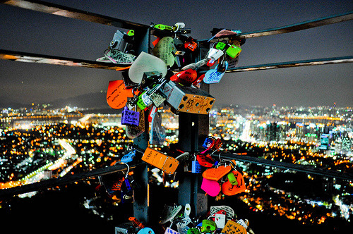 "loveletmesleep:  love locks are a custom by which lovers sweethearts affix padlocks to a fence or similar public fixture & throw away the key, to symbolise their everlasting love. they are most commonly placed on the railings of bridges.the custom of love padlocks has become internationally popular, & in serbia can be traced to before world war I, where a schoolmistress from vrnjačka banja, nada, fell in love with a serbian officer, relja. after they got engaged relja went to war in greece where he fell in love with another woman. nada never recovered from the blow, & died as a result of her unfortunate love. as young girls from vrnjačka banja wanted to protect their own loves they started writing the names of their loved ones on padlocks, attached to the railings of the bridge where nada & relja used to meet. it's now acquired the name ""bridge of love"".love padlocks have also gained a significant presence in italy, starting at the bridge ponte milvio in rome. in england they are attached to various points along the fence on tower bridge, london. in paris, the pont de arts, passerelle léopold-sédar-senghor & pont de l'archevêché bridges. in the USA love padlocks can be seen in guam's ""two lovers' point"", a viewing deck overlooking the ocean & hundreds are hanging on the brooklyn bridge, in NYC. chicago has also seen a rise in this tradition: the michigan avenue bridge is bound with a lock representing a couple's transatlantic love."
