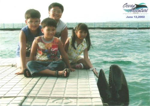 As I was looking through the old pictures in my dad's folder, I saw this. :)) Hahaha. This photo was taken back in 2002 when I was about 6-7 years old. I didn't really know I had full bangs back then. :))
