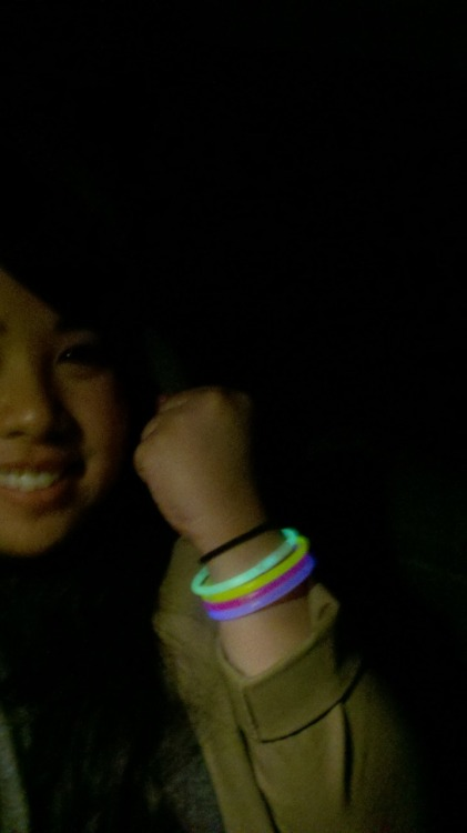 Looked through my box of camping stuff for Hy, and found these glowstick bracelets that I put on the kids at our family camping trip.  I cracked 1, 2 … then 3 glowsticks, none of them worked. So I cracked the last 7 all at once, and these 4 were the survivors. Then I got sad that I wasted them all.So I wore them. And that is the story of THAT.  OH and note that, I don't know how to take self photos on my droid.  I actually don't even know how to use the flash, so I had to turn on my car lights.  Oy yoi.