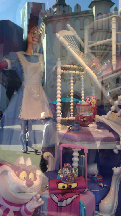 it's hard to see but in this window display at euro disney, cruella deville is wearing alice's dress