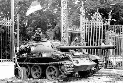 "A North Vietnamese tank breaking through the gate to Independence Palace, thus marking the fall of Saigon and the end of the Vietnam war. The complex would later be renamed ""Reunification Palace"" by the new Communist government to celebrate the joining of North and South Vietnam. April 30, 1975."
