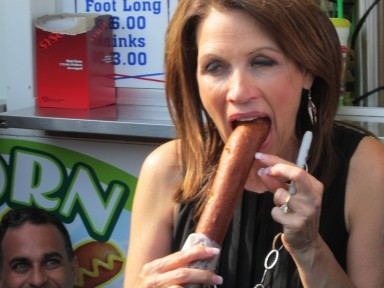 Michele Bachmann eating a corn dog. Okay. I think Michele Bachmann is about as crazy as it gets, but this is the most blatant sexism I've ever seen in an article. The woman is psycho enough that we can stick to making fun of her beliefs. I must say, though, I find it a little difficult not to laugh. I'll chalk that one up to how much I despise her out-dated, parochial, and intolerant policies. Click through to see the full Telegraph article.