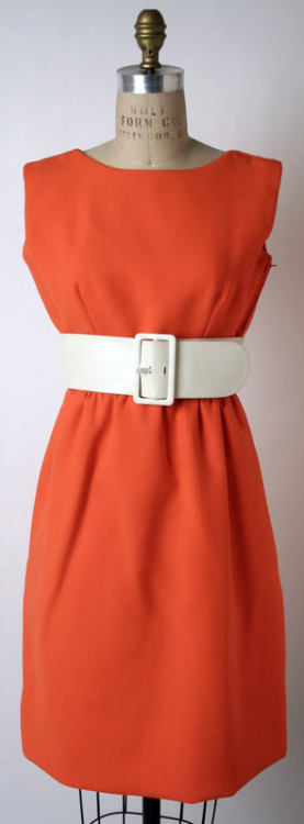 A cute orange day dress with a wide belt from Norman Norell's Spring-Summer 1968 collection.