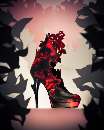shoelust:  Enikő Tóth-Kern    Gorgeous boots. I really like the sculpted heel and floral cutouts