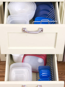 storagegeek:  Repurpose a CD rack into a tupperware lid organizer! Brilliant tip from those clever folks at Better Homes & Gardens.
