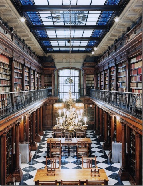 libbyvertz:    Trinity College, Dublin. I love how this is both terribly classic, old-school university design, but it also looks almost luxurious, with the warm chandellier and the glossy table tops. Photo from parishotelboutique.blogspot.com via 2headedsnake