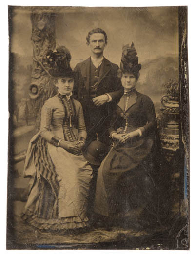 oldrags:  Tintype of a married couple and unidentified woman, ca 1880's US (Virginia)