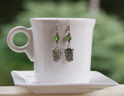 littlefever:  (via Green Eyed Owl Earrings Silver Woodland Owl Charms by littlefever)  super cute