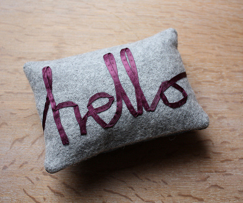 recycledfrockery:   DIY Ribbon Pillow. Found at FontCrafts here. Sew ribbon on pillows to spell simple words. Made with wool flannel and ribbon via MeMake on Flickr.