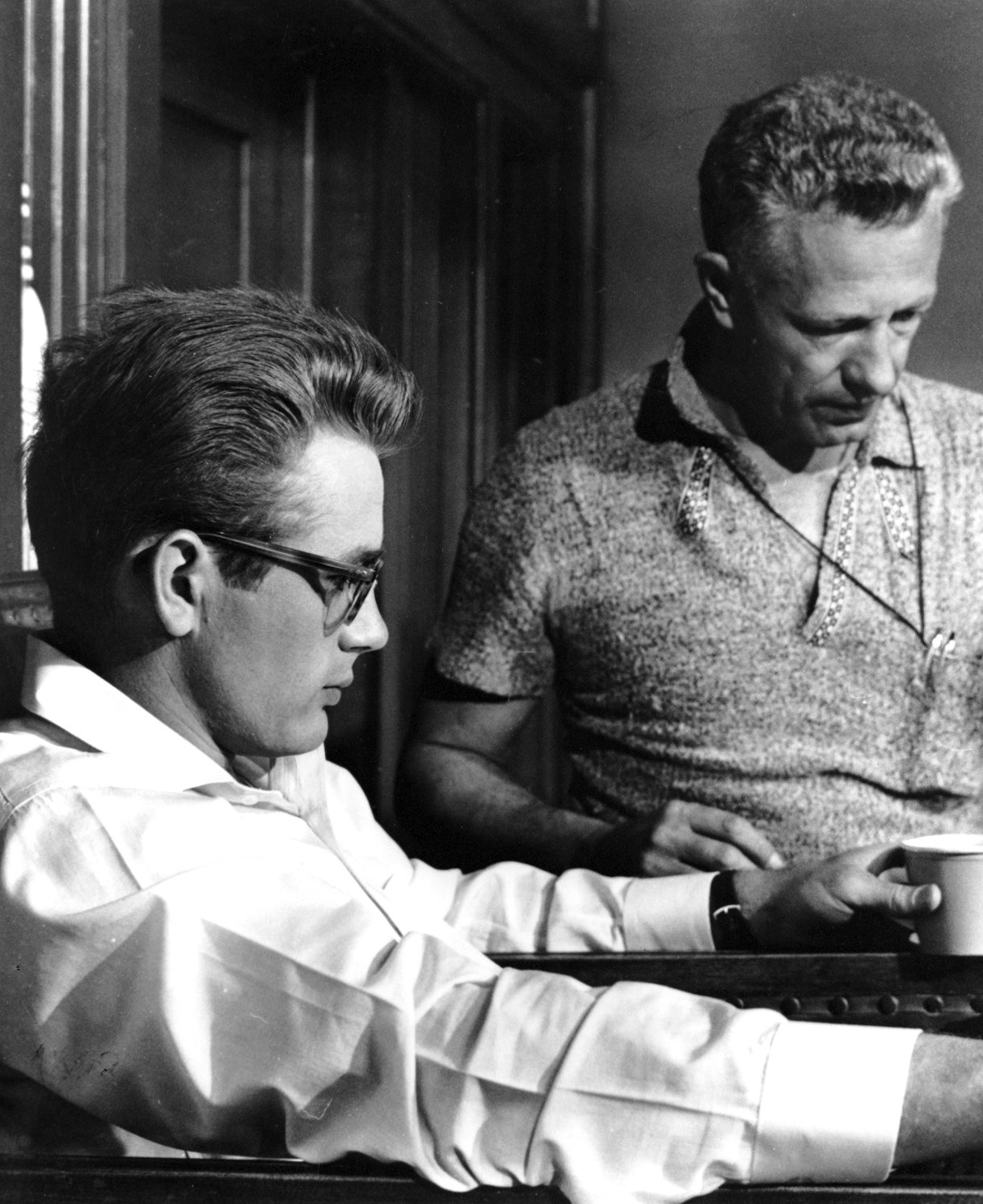 jamesdeandaily:  James Dean and director Nick Ray on the set of Rebel Without a Cause, 1955.  My heroes are no more neurotic than the audience. Unless you can feel that a hero is just as fucked up as you are, and that you would make the same mistakes that he would make, you can have no satisfaction when he does commit a heroic act. - Nick Ray