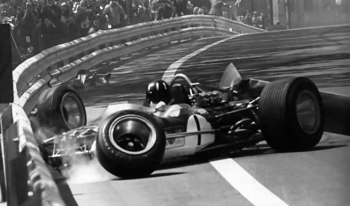 Graham Hill - Spanish Grand Prix, 1969. The rear wing strut fails in his Lotus 49B, forcing him to have a crash.