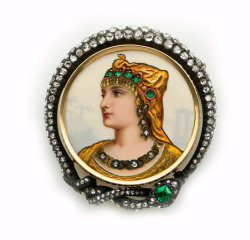 maudelynn:  Limoges enamel, emerald, rose-cut diamond, silver and gold portrait brooch surrounded by a serpent.  Golay et Fils, Geneve.   Dramatic piece of jewelry with a frame of rose cut diamonds in the form of a snake. Limoges enamel portrait brooches were popular in the late 1800's and usually represented a famous actress or classical opera diva in stage costume. c.1897 price; $11,000.00  A-MAZING !