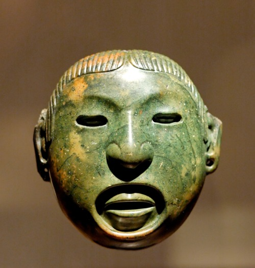 "absurdonio:   Pendant-mask associated to the rituals of Aztec god Xipe Totec  (""our lord the flayed one"").  Stone, Mexico Valley, 15th century–before 1521. Louvre Museum (Musée du Louvre) via Wikipedia"