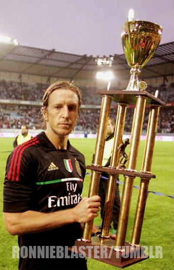ronnieblaster:  A.C. Milan won the Champions Game Cup. Massimo Ambrosini has raised the third trophy in the space of time of 4 months.  lol can't get over how huge that trophy is