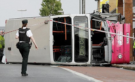 30 injured as double decker bus overturns in Belfast after hitting a kerb  Read more: http://www.dailymail.co.uk/news/article-2025958/30-injured-double-decker-bus-overturns-Belfast-hitting-kerb.html#ixzz1V2WRI3GL