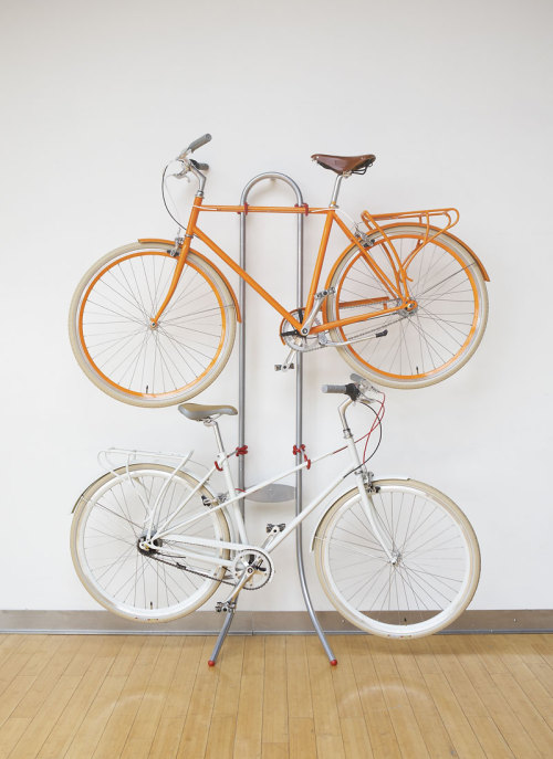 "rozanes:  ReCraft Your Bike Stand""s"": Michelangelo Two Bike Gravity Stand If you need someplace to keep two bikes in your home, or simply don't want to put holes in your wall, this ingenious wall rack offers a fast, sleek-looking solution. It has the easiest installation process we've ever come across. Just lean it against the wall and presto. Gravity does the rest. Seriously, you'll be pleasantly surprised to see just how well it works. Great for all shapes and sizes of bikes.—————————————————————————————————Displayed on Recraft 
