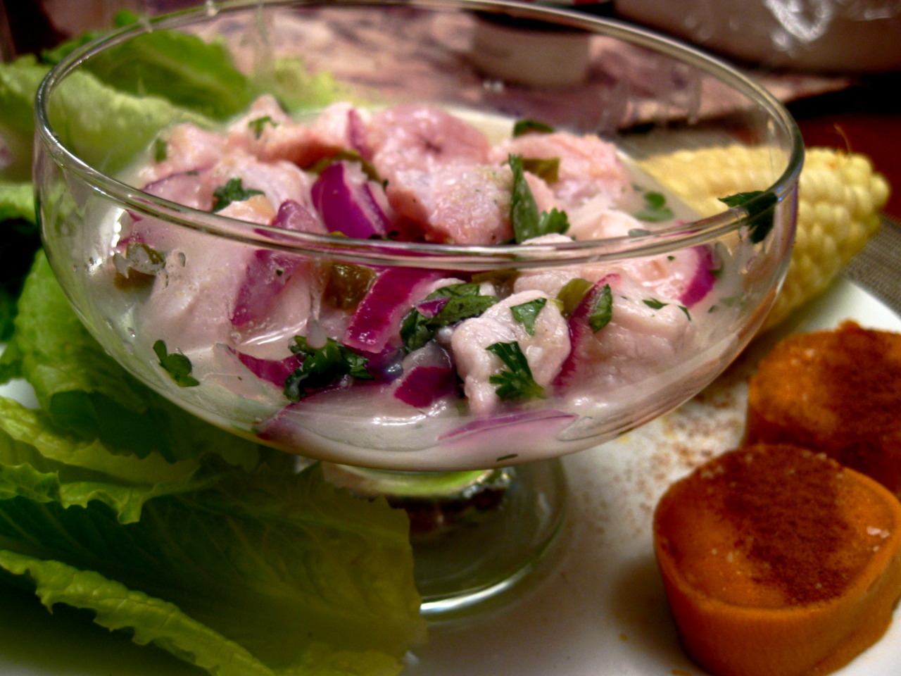 Dinner this evening: Peruvian Ceviche with Sweet Potato, Corn and Romaine This is the most incredible dish especially when served with some lovely fresh basa-swai fillets (which I purchased this afternoon at the 99 Ranch Market) and gorgeous freshly squeezed limes. My other adaptations included a bit of garlic parsley salt and I used serrano and jalapeno chili peppers instead of habanero (since I didn't have any on hand.) I ate them like little lettuce tacos with a bit of corn and sweet potato wraped around the ceviche. They all pair so wonderfully together. Nomz nom nom nom.