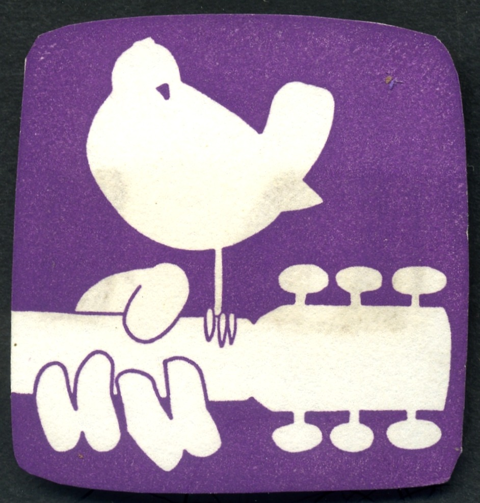 Woodstock sticker, 1969 Designed by Arnold Skolnick and taken from his iconic Woodstock Poster  The mother of all festivals, dubbed An Aquarian Exposition: 3 Days of Peace & Music, kicked off 42 years ago today via Golden Age Comic Book Stories