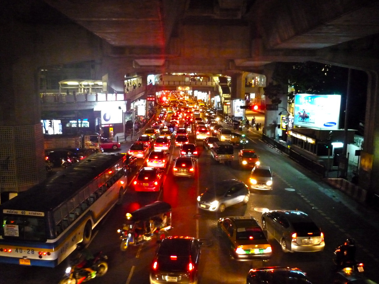 The infamous Bangkok Jam. Vehicles slither in and out, sometimes in totally opposite direction, a dangerous feat only the Thais are used to. Taxi cabs have no backseat safety belts, leaving the passengers to hope in prayers and keep awake till the time runs out and the meter runs on.