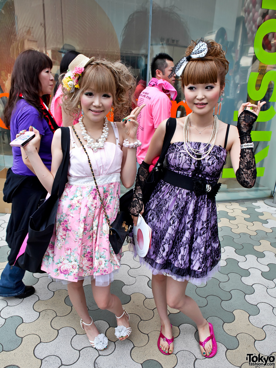Japanese girls in empire waist dresses near LaForet Harajuku.