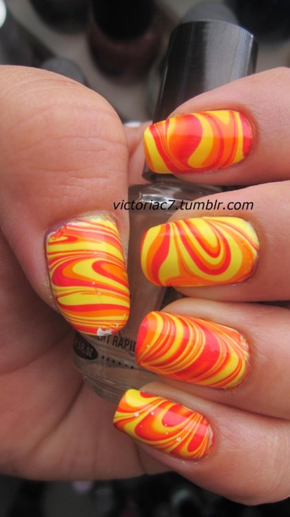 victoriac7:  Warm water marble! Colors used:  Essie - Lollipop Sally Hansen X-treme Wear - Sun Kissed Sally Hansen X-treme Wear - Mellow Yellow