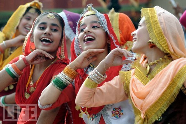 "life:  Busting a Move — Indian  schoolgirls wearing traditional Punjabi dresses perform the ""giddha""  folk dance during their country's Independence Day celebrations in Wagah  on Monday. see more — Colorful Scenes from India"