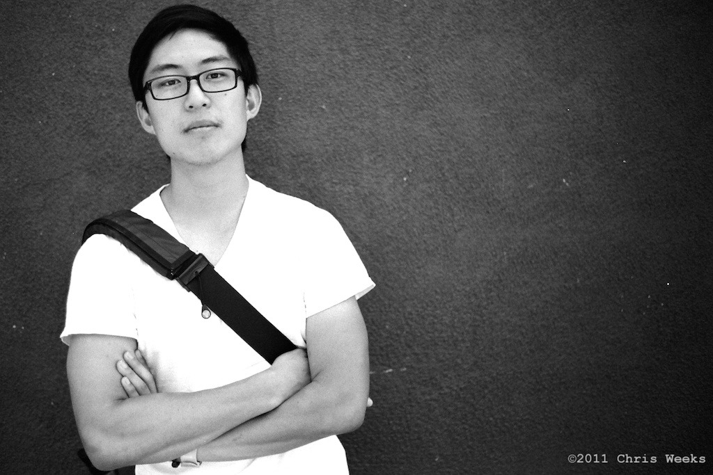 Silver Lake (Los Angeles), Calif.: August, 2011.  Met up with Eric Kim for coffee, which he should never drink as he has enough energy for 3 people.  Very enthusiastic street photographer.  Really nice kid.  Had to tell him not to smile to make this photo, though. ;)  Leica MP.  35 'cron.  Agfa APX 25.