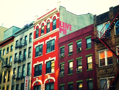 "nythroughthelens:  Love me - street art writing. Chinatown, New York City. Little surprises like hot pink incantations nestled in among brightly colored tenements enchant the urban environment with a whimsical quality. These fleeting incantations stand out as thoughts breaking their way through the immense density of structures let loose if only for a brief amount of time. —- View this photo larger and on black on my Google Plus page —- Buy ""Love Me - Chinatown - New York City"" Posters and Prints here, View my store, email me, or ask for help."