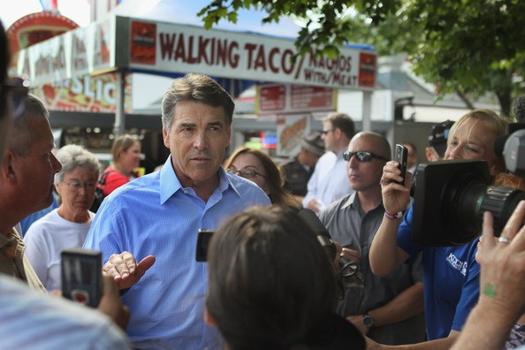 Bag's Take-Away:  Photogs wrestling with Perry, #2.  And then, from Getty's Scott Olson, there's always Perry (a retort to The Big Hat looking reflective) as Walking Taco — as in, 'I can walk-o, and talk-o, at the same time').   (photo: Scott Olson/Getty Images caption: Republican presidential candidate and Texas Governor Rick Perry greats guests at the Iowa State Fair August 15, 2011 in Des Moines, Iowa. The visit is part of Perry's first campaign trip to Iowa since declaring he would seek the Republican nomination for president on August 13.) ————— Topping LIFE.com's 2011 list of Best Photo Blogs, follow us at: BagNewsNotes; BAG Twitter; BAG Facebook; Bag by Email.