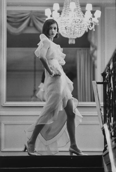 Model Prunelia wearing a Marc Bohan evening dress (1968). Bill Ray. (Source)
