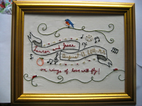 For Lauren and Jesse, finished 8/12/11. (This is a wedding gift. The couple has lived in New York (bluebird), Massachusetts (ladybug— who knew?), and now Georgia (peach, natch), and both have a passion for music. And sand dollars. Hence all the stuff around the banner.)