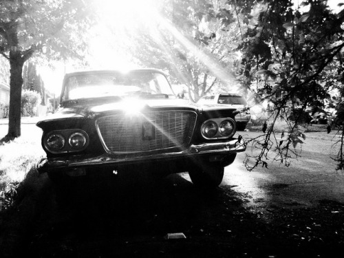 "mobilephotogroup:  Dream Car  By Star Rush ""America is a dream / The poet says it was promises /  The people say it is promises—that will come true,""    —Langston Hughes (The Collected Poems of Langston Hughes)  Go! On the move. Rubber. Steel. Chrome. The vehicles that take us to and from our destinations also give us a glimpse into our selves, our past and our cultural, collective, and personal identities. Cars. An Open Road. Freedom. Consumption. Promises.  Taken on the streets of Seattle, this series explores feelings that cars of the 1960s and 1970s evoke in me, an immigrant, of an American past that's hard to get a handle on. Cars have a close association with America's cultural mythos of mobility, independence, self-reliance, consumption and the ethos of cool. Jack Kerouac romanticized them as he explicated ""the road,"" about driving away and watching people on the horizon receding as cars pull away from one place to head to another. But the gaze turns from inside to outside; I'm standing here, watching these cars pull away from me, receding into miles that stretch from such an idealistic vision of wants, of careless highways, dark and starry nights in a mythical west, to an endlessly deferred horizon. It keeps me from looking too closely at the debris and residue between here and there. What fuels this imagining? What sustains the consumption and recycling of past into present?  I'm not sure if I'm nostalgic or sentimental.    A symbol of the American Dream, a car is a metaphor built of imagination and steel, sculpted forms, the output of manufacturing lines and factories, hot sparks, physical labor, sweaty brows—the design of a dream. Whose dream?  All over Seattle, I find the cars of my own childhood, now there, suddenly parked, at the corner of a street … and they're here, in another America, today. I'm provoked by the juxtaposition of that scene between what is arriving and what is departing. What am I recovering in these images, these observations of old cars parked on city streets, artifacts from somewhere else that are as far away from me as a fuzzy dream, one I struggle to recall throughout the day and can't.   Click through and check out Star Rush's beautiful black and white image of classic american cars taken on the streets of Seattle.  The photo series is exclusive to The Mobile Photo Group."