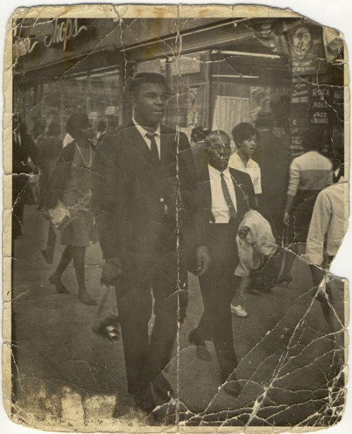 mpdrolet:  Cassius Clay on the street with his bodyguard James Spencer