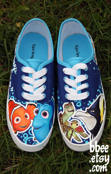 "bbeeshoes:  I painted these shoes for Nicola in Vancouver. They are Finding Nemo themed. I painted Nemo and Dory on the right shoe, and Crush, Squirt and Gill on the left shoe. On the sides I painted a bunch of Nemo's fish friends, with the quote ""Just keep swimming""."