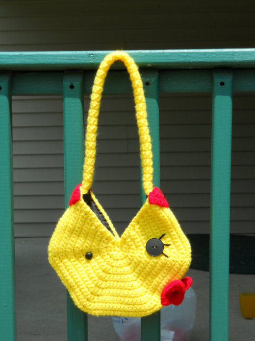 Ms. Pacman Purse - by crittercre8r Purse is held shut with a small loop that hooks over the eye on the pack of the purse! Lined with black fabric, so small items won't fall through the stitches. Available for $35 USD at Etsy.