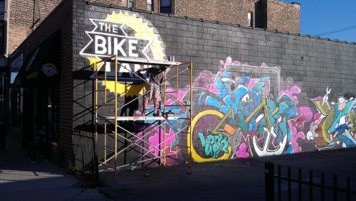 Painting the bike shop's logo and a mural on Flickr.I really like this. The shop's logo is beautiful, and the mural contrasts its simplicity with wild and colorful forms.