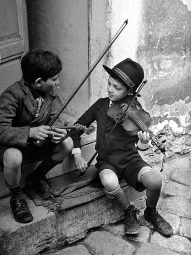 gypsy children playing violin in street, budapest, hungary, 1939 photo by n.r. farbman