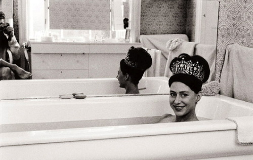 thefutureoftheworldhangsonyes:  HRH Princess Margaret in the bath, photographed by her husband, the Earl of Snowdon.  If I were a princess, I would always wear a tiara in the bath. Plus the bathtub would be full of gin. In Margaret's case, it probably was.