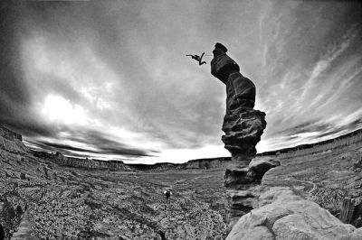 "BASE Jumping Utah's Ancient Art Screen capture by Keith Ladzinski ""At this very moment, the thinking is over and your mind is in 'enjoy' mode,"" says climber Mario Richard (center) of two-way BASE jumping with Steph Davis (lower center) off the Corkscrew summit of Ancient Art at Fisher Towers near Moab, Utah. ""It's time to take in some amazing visuals and savor the fruits of all the efforts it took to get there."" The pair free climbed three short pitches and one long one to get to the narrow summit of this iconic desert tower recognized by most rock climbers. In a two-way the jumpers take off nearly simultaneously, just a split second apart. Timing is important because if they don't have enough separation, they could jump into each other's parachutes. ""We jump together a lot, and it seemed like it would be a fun twist to jump together from this tower where it's hard to even fit one person at the top,"" notes Davis, of the two BASE jumps she and Richard did that day. ""We do two-ways off Castleton quite a bit, too—and with our wingsuits."" Read more in our Extreme Photo of the Week gallery» Photographer Keith Ladzinski"