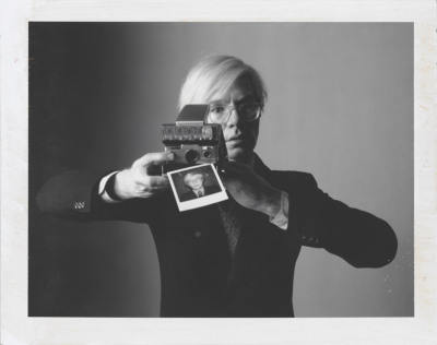 standingatadistance:  Andy Warhol with Camera, Oliviero Toscani. 1974 Polaroid type 105