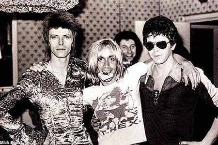 [Image is David Bowie, Iggy Pop, and Lou Reed standing in a line with their arms around each other's shoulders.  End description.] We're all motherfucking friends here.