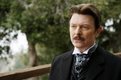 [Image is David Bowie as Nikola Tesla in the film The Prestige.  He's in a suit and has grown a mustache.  End description.] Another fucking thing to add to the list.  He's an alien, Goblin King, singer, super villain, inventor.  Damn.