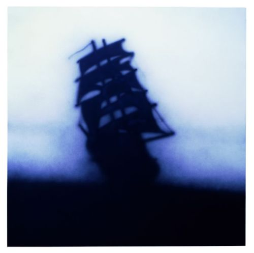 Untitled, (Galleon Ship Silhouette), 1986. by Ed Ruscha.  Acrylic on Canvas. Artist Profile: Ed Ruscha                             The soulful and gripping artwork of Ed Ruscha has been a part of my  creative voice since I first saw his acrylic ship paintings.  Ruscha's  work is diverse, stretching from design and illustrative influences to  contemporary work.                    The delicate, moody yet serious tones strike a chord within me.  Its  as if at first glance he illustrated something I have thought or felt  before.                     Fortunately, Rushca's work and exhibits are available to browse through his website.  A diverse collection is available on the Gagosian Gallery's website.  If you're in the LA area, the Hammer museum is featuring solo exhibit on Rushca titled, On the Road.  It's  times like these that provoke artists to appreciate the gifts of the  living artists, the beautiful impact they have on us and society.                       I am simple an enthusiast of his work.  I would greatly appreciate  more information or feedback.  Please leave your impressions of Ruscha  below or through email.                      I also have a Facebook page and Twitter profile, if you love art, keep in touch, the internet inspires and brings us all together.