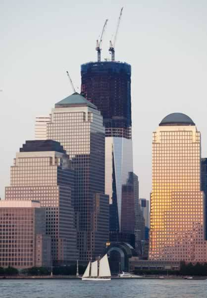 thegreg:  producermatthew:  The construction of One World Trade Center is hardly mentioned in the media, yet here it is: The first post-September 11 tower stands 76 stories high at the moment and will be at 104 floors high by the time it is finished. [August 2, 2011/AP Photo]  I watch it rise every day… and was just wondering today how high it was currently.  Yeah, New York baby standing tall. Nothing brings us down.