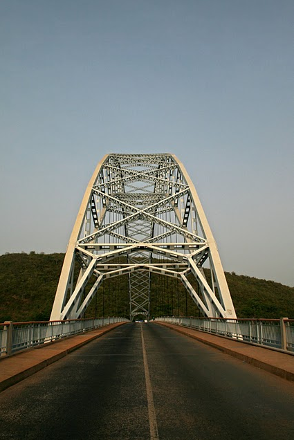 Ghana's InfrastructureAdomi (Ah-door-me) bridge is a national icon. It runs across the Volta river.