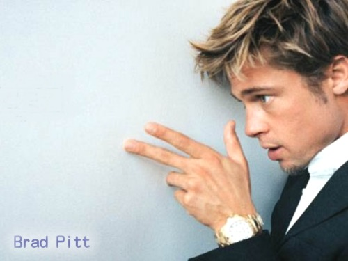 Brad Pitt , all seeing eye, Dragon/Cosmos/Baphomet salute