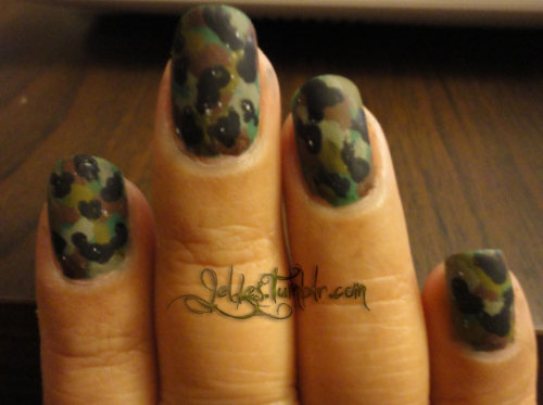 jelles:  Nails I did for my brother's promotion party. Ulta The Jungle Look Revlon Chocolate Truffle Sally Hansen Xtreme Wear Blackout Kleancolor Fashionista Fingerpaints Military Green Essie Matte about you