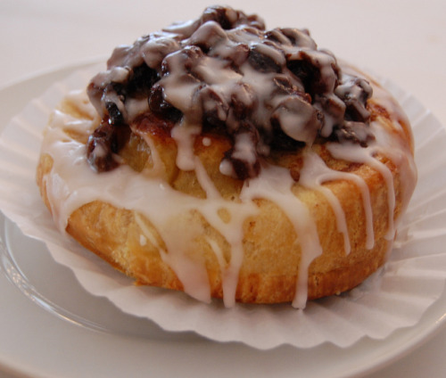 Sophie's Cinnamon Roll with a mound of raisins by Mr. Tender Branson on Flickr.